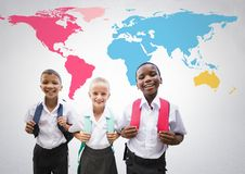 School kids in front of colorful world map. Digital composite of School kids in front of colorful world map Royalty Free Stock Images