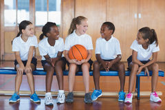School kids having fun in basketball court Royalty Free Stock Photography