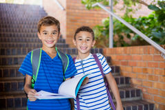 School kids holding a book on staircase Royalty Free Stock Photos