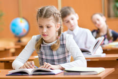 School kids at lesson in classroom Stock Photos