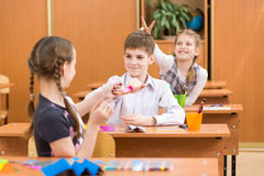 School kids at lesson in classroom Royalty Free Stock Photos