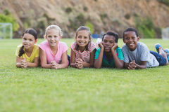 School kids lying on playground Stock Photography