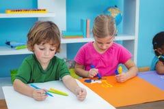 School kids making art at their desk Royalty Free Stock Image