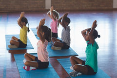 School kids meditating during yoga class Stock Image