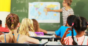 School kids raising hand in classroom stock footage