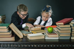 School kids reading a book at library Stock Image