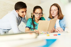School Kids Reading Book Together royalty free stock photo