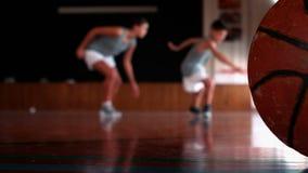 School kids running on basketball court. At school stock video footage