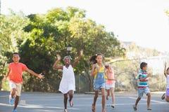 School kids running in school campus Stock Photos