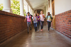 School kids running in school corridor Royalty Free Stock Photo