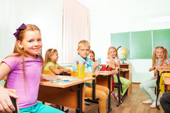 School kids sitting at studying desks in class Stock Photos