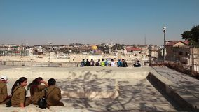 School Kids and Soldiers Looking at the Dome of the Rock from a Rooftop  in Jerusalem stock video footage