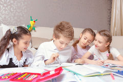 School kids study at home Stock Photos