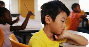 School kids styling in classroom stock video