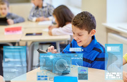 School kids with tablet pc in classroom Royalty Free Stock Image