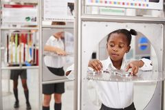 School kids taking part in science tests at a science centre royalty free stock photography