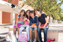 School kids taking selfies. School kids taking pictures with selfie stick royalty free stock images