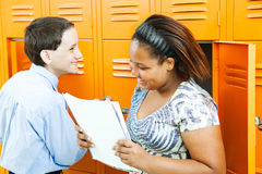 School Kids Talking by Lockers. Middle school boy and girl talking together by the lockers stock photography