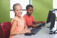 School kids using computer in classroom Stock Images