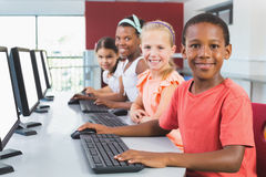 School kids using computer in classroom Stock Photo