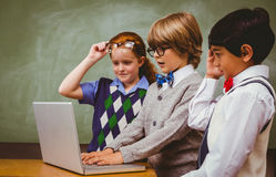School kids using laptop in classroom Royalty Free Stock Photography