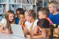 School kids using laptop in library. At school Royalty Free Stock Photo