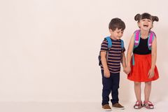 Free School Kids With Backpacks Holding White Blank Or White Card. Stock Photo - 153016120