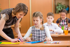 School kids work at labour lesson Stock Photos