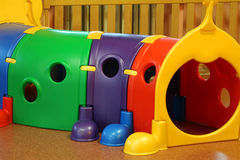 School with large plastic tunnels game for preschoolers. Kindergarten hall with large plastic tunnels game for preschoolers Stock Photo