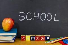 School learning abc blocks apple text books reading stock photos