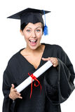 School leaver with the certificate. Graduating student in academic black gown and square cap with the diploma, isolated royalty free stock image