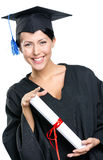 School leaver with the diploma. Graduating student in academic black gown and square cap with the certificate, isolated stock image
