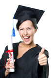 School leaver with the diploma thumbs up. Graduating student with the certificate and in the black academic gown thumbs up, isolated stock photography
