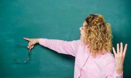 School lesson knowledge. Remember this. Strict woman teacher pointing at chalkboard. Informing kids. School rules