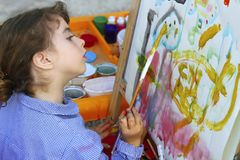 School little girl painting watercolors portrait Royalty Free Stock Image