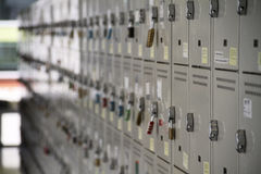 School lockers. A perspective view of a stack of white metal school lockers, some with locks royalty free stock photos