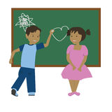School love. Boy drawing a heart to his sympathy Royalty Free Stock Images