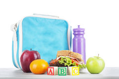 School lunch with alphabet blocks Royalty Free Stock Images