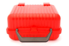 School lunch box. Front view of a red plastic suitcase for kids lunch box. Image isolated on white studio background Stock Photography