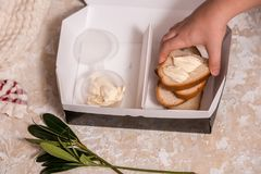 School lunch box for kids. Back to school. Child's hands. Top view, flat lay. School lunch box for kids. Back to school. Child's hands. White bread and butter in royalty free stock photography