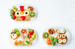 School lunch box for kids with food in the form of funny faces. The toning. selective focus stock photography