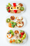 School lunch box for kids with food in the form of funny faces. The toning. selective focus royalty free stock photography