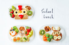 School lunch box for kids with food in the form of funny faces Stock Photos