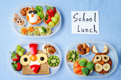 School lunch box for kids with food in the form of funny faces. The toning. selective focus royalty free stock images