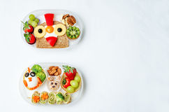 School lunch box for kids with food in the form of funny faces. The toning. selective focus stock image