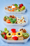 School lunch box for kids with food in the form of funny faces Royalty Free Stock Photo