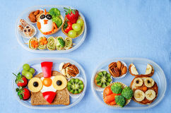 School lunch box for kids with food in the form of funny faces. The toning. selective focus royalty free stock photo