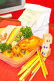 School lunch box with paper bag and postie surprise message. Stock Image