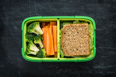 School lunch box with sandwich, broccoli and carrot stock photos