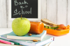 School lunch box with sandwich, fruits and nuts Stock Images